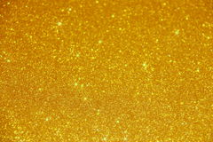 Guld blänker gnistrandebakgrund - materielfoto royaltyfria bilder