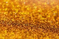 Guld blänker stjärnaglödbakgrund Arkivbilder