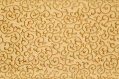 Guld- blom- bakgrund Arkivfoto