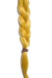 Guld- blont hår som flätas i råttsvans Royaltyfria Bilder