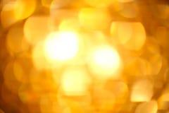 Guld- bokeh Royaltyfri Fotografi