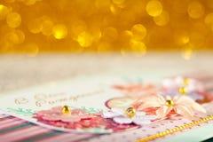 Guld- bokeh, abstrakt bakgrund Arkivfoto