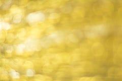 Guld- Bokeh abstrakt bakgrund Royaltyfri Foto