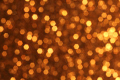 Guld- Bokeh bakgrund Royaltyfri Foto