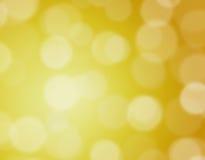 Guld- bokehbakgrund Royaltyfria Bilder