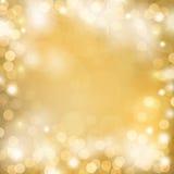 Guld- bokehbakgrund Fotografering för Bildbyråer