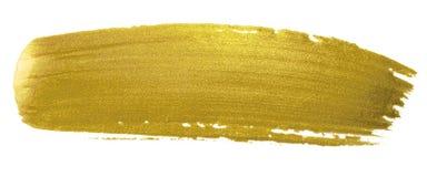 Guld- borstemålarfärgslaglängd För färgsudd för akryl guld- fläck på vit bakgrund Blänka det guld- banret med glansig textur för  Arkivfoto