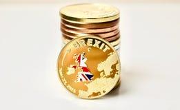 Guld- brexitmynt Fotografering för Bildbyråer