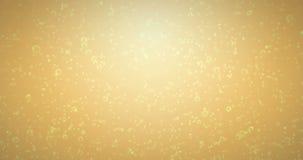 Guld- bubblarörelse inom ett exponeringsglas av champagne på guld- bakgrund