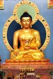 Guld- Buddha för sammanträde i den datsaneRinpoche Bagsha neaen Royaltyfri Fotografi