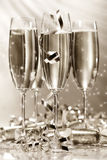 guld- champagneexponeringsglas royaltyfria foton