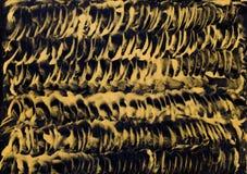 Guld- coils som målar i wax arkivbild