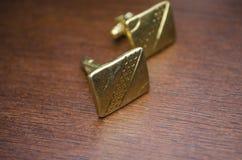 Guld- cufflinks Royaltyfri Foto