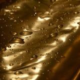 Guld- droppar av vatten Royaltyfria Bilder