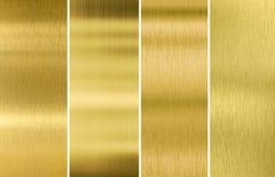 Guld eller mässing borstade metalltexturbakgrunder Arkivfoto