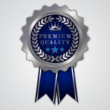 Guld- emblem för vektorabstrakt begrepprunda med bandet och Royaltyfria Foton