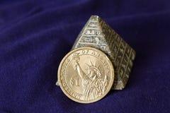 Guld- ett dollarmynt Arkivbild