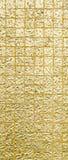 Guld- färg för thailändsk tradition av väggen för text och bakgrund arkivbilder
