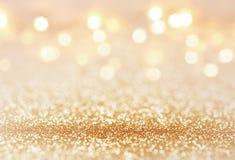 Guld- färgabstrakt begrepp blänker texturbakgrund för ferier Royaltyfri Fotografi
