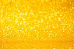 Guld- färgbokeh blänker bakgrund Arkivfoton