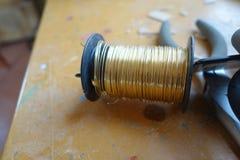 Guld- färghantverktråd Arkivbilder