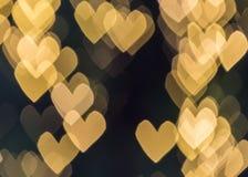 Guld- färghjärtabakgrund Royaltyfri Fotografi