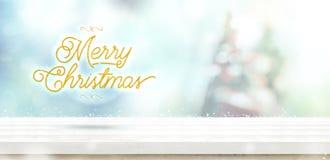 Guld för glad jul blänker på den vita trätabellen med abstrakt begrepp royaltyfri foto