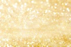Guld- feriebakgrundsbokeh abstrakt bakgrund Arkivbild