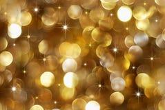 guld- ferielampor för bakgrund Arkivbild