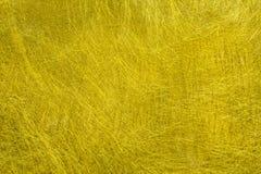 Guld- fibertextur Arkivfoto