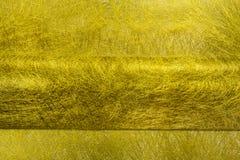 Guld- fibertextur för veck Arkivfoton