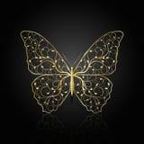 Guld- fjäril med den blom- modellen Arkivfoto