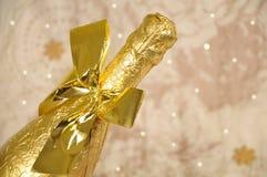 guld- flaskchampagne Arkivbild