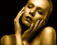 Guld- flicka Royaltyfri Bild
