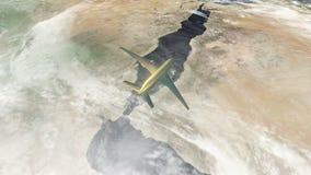 Guld- flygplan som flyger över Saudiarabien och jeddah arkivfilmer