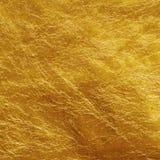 Guld- folie arkivbild