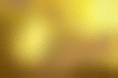 Guld- folietexturbakgrund Arkivfoton