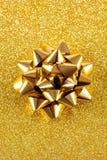 Guld- gåvapilbåge Arkivbild
