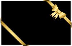 Guld- gåvapilbåge med band Arkivbilder