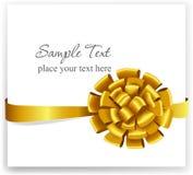 Guld- gåvapilbåge med band Royaltyfri Bild