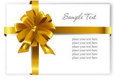 Guld- gåvapilbåge med band Royaltyfria Bilder