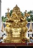Guld- Ganesha (Ganesh, Ganapati) staty. Fotografering för Bildbyråer