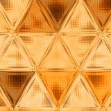 Guld- geometrisk bakgrund för abstrakt triangel med lutningbelysning Arkivfoton
