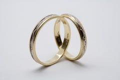 guld- gifta sig för cirklar Arkivfoto