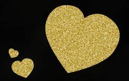 Guld- giltterhjärtabakgrund Royaltyfria Bilder