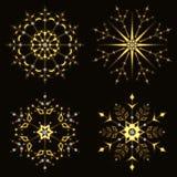 Guld- glänsande snöflinga Arkivbilder