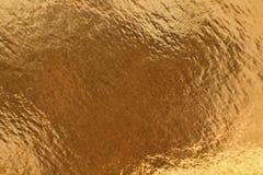 Guld- glansig texturmodell som abstrakt bakgrund Fotografering för Bildbyråer