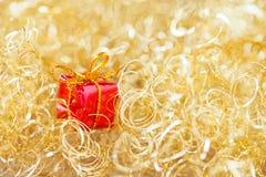 Guld- glimtjulbakgrund Royaltyfria Bilder