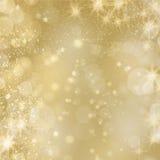 Guld- glinstering bakgrund med stjärnor och ljus Arkivbild