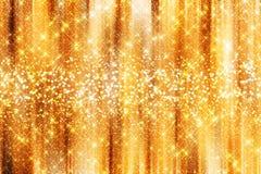 Guld- gnistrandebakgrund Fotografering för Bildbyråer